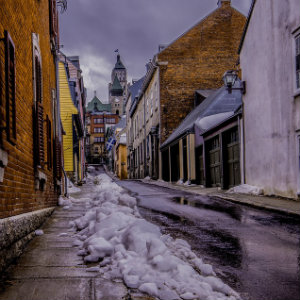 snowy side street in quebec
